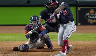 FILE - In this Oct. 30, 2019, file photo, Washington Nationals' Howie Kendrick hits a two-run home run against the Houston Astros during the seventh inning of Game 7 of the baseball World Series, in Houston. A person with knowledge of the negotiations tells the AP that postseason star Howie Kendrick and the World Series champion Washington Nationals agreed in principle to a one-year contract worth $6.25 million. The person spoke on condition of anonymity because the deal is still pending a successful physical. (AP Photo/Eric Gay)