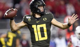 Oregon quarterback Justin Herbert throws a pass against Utah during the second half of the Pac-12 Conference championship NCAA college football game in Santa Clara, Calif., Friday, Dec. 6, 2018. (AP Photo/Tony Avelar)