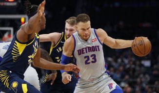 Detroit Pistons forward Blake Griffin (23) is defended by Indiana Pacers center Myles Turner (33) during the first half of an NBA basketball game Friday, Dec. 6, 2019, in Detroit. (AP Photo/Carlos Osorio)