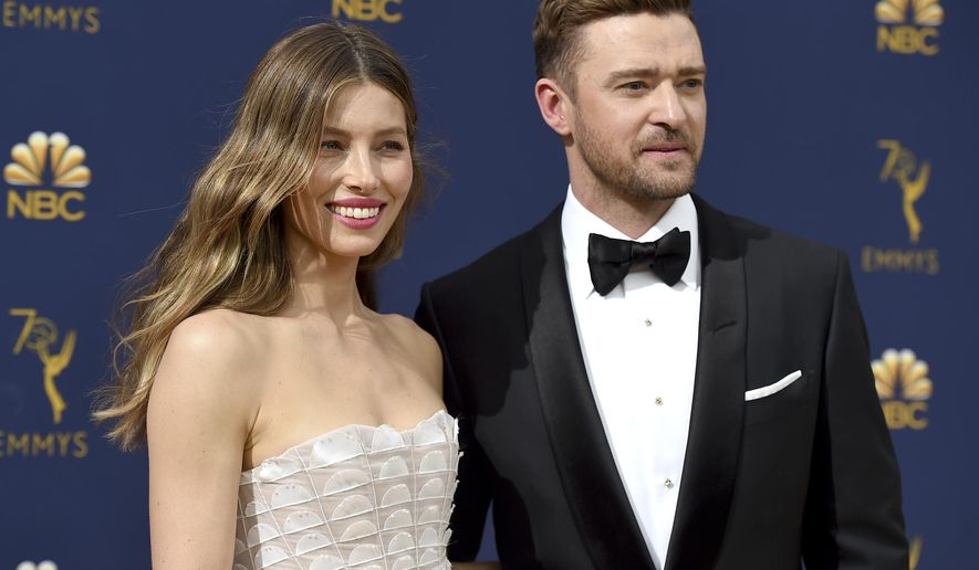 "FILE - In this Sept. 17, 2018 file photo Jessica Biel, left, and Justin Timberlake arrive at the 70th Primetime Emmy Awards in Los Angeles. Timberlake has publicly apologized to his actress-wife Jessie Biel weeks after he was seen holding hands with the co-star of his upcoming movie. The pop star and actor wrote on Instagram, Wednesday, Dec. 4, 2019, that he prefers to ""stay away from gossip as much as I can, but for my family I feel it is important to address recent rumors that are hurting the people I love."" (Photo by Jordan Strauss/Invision/AP, File)"