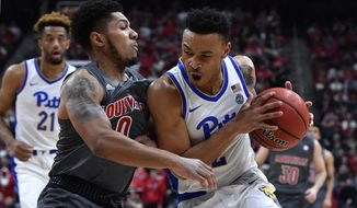 Pittsburgh guard Trey McGowens (2) attempts to drive through the defense of Louisville guard Lamarr Kimble (0) during the first half of an NCAA college basketball game in Louisville, Ky., Friday, Dec. 6, 2019. (AP Photo/Timothy D. Easley)