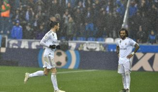 Real Madrid's Gareth Bale, left, leaves the pitch as Marcelo looks on during the Spanish La Liga soccer match between Real Madrid and Alaves at Mendizorroza stadium, in Vitoria, northern Spain, Saturday, Nov. 30, 2019. (AP Photo/Alvaro Barrientos)