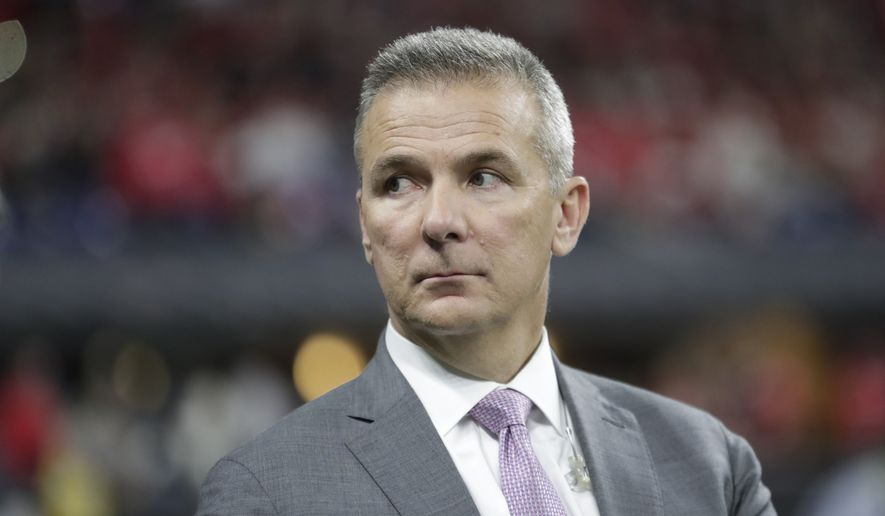 Former Ohio State head coach Urban Meyer watches during the second half of the Big Ten championship NCAA college football game between Ohio State and Wisconsin, Saturday, Dec. 7, 2019, in Indianapolis. (AP Photo/Michael Conroy) ** FILE **