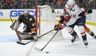 Washington Capitals left wing Jakub Vrana, right, tries to get a shot in on Anaheim Ducks goaltender Ryan Miller during the third period of an NHL hockey game Friday, Dec. 6, 2019, in Anaheim, Calif. The Capitals won 3-2. (AP Photo/Mark J. Terrill) ** FILE **