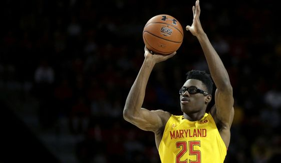 Maryland forward Jalen Smith shoots a three-point basket against Illinois during the second half of an NCAA college basketball game, Saturday, Dec. 7, 2019, in College Park, Md. Maryland won 59-58. (AP Photo/Julio Cortez) **FILE**
