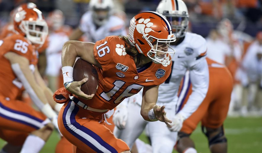 Clemson quarterback Trevor Lawrence (16) runs against Virginia during the first half of the Atlantic Coast Conference championship NCAA college football game in Charlotte, N.C., Saturday, Dec. 7, 2019. (AP Photo/Mike McCarn) ** FILE **