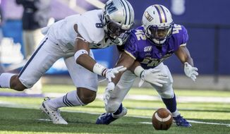 Monmouth linebacker DeJaun Cooper (8) and James Madison running back Solomon Vanhorse (42) chase down a Monmouth fumble during the opening kickoff during the first half of a second-round game in the NCAA Football Championship Subdivision playoffs Saturday, Dec. 7, 2019, in Harrisonburg, Va. (Daniel Lin/Daily News-Record via AP)
