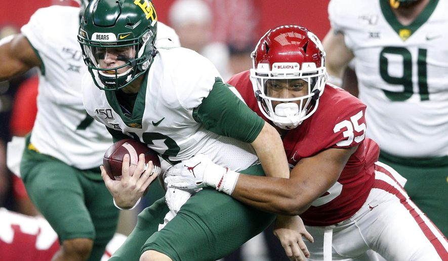 Oklahoma linebacker Nik Bonitto (35) sacks Baylor quarterback Charlie Brewer (12) during an NCAA college football game for the Big 12 Conference championship, Saturday, Dec. 7, 2019, in Arlington, Texas. (Ian Maule/Tulsa World via AP)