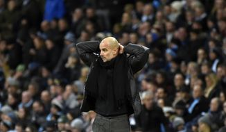Manchester City's head coach Pep Guardiola reacts during the English Premier League soccer match between Manchester City and Manchester United at Etihad stadium in Manchester, England, Saturday, Dec. 7, 2019. (AP Photo/Rui Vieira)