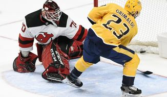 Nashville Predators right wing Rocco Grimaldi (23) scores against New Jersey Devils goaltender Louis Domingue (70) during the third period of an NHL hockey game Saturday, Dec. 7, 2019, in Nashville, Tenn. The Predators won 6-4. (AP Photo/Mark Zaleski)