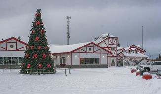 This Nov. 22, 2019 photo, shows the renovated Santa Claus House in North Pole, Alaska. The house now has double the amount of retail space and more displays and attractions for visitors. (Alistair Gardner/Fairbanks Daily News-Miner via AP)