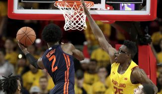 Illinois forward Kipper Nichols (2) goes up for a shot against Maryland forward Jalen Smith (25) during the second half of an NCAA college basketball game, Saturday, Dec. 7, 2019, in College Park, Md. Maryland won 59-58. (AP Photo/Julio Cortez) ** FILE **