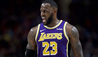 Los Angeles Lakers forward LeBron James reacts after scoring against the Portland Trail Blazers during the first half of an NBA basketball game in Portland, Ore., Friday, Dec. 6, 2019. (AP Photo/Craig Mitchelldyer)