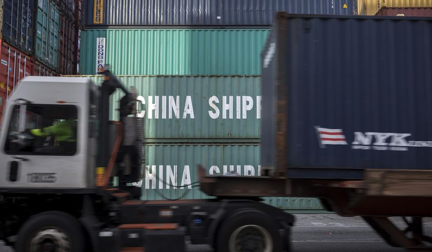 In this Thursday, July, 5, 2018, photo, a jockey truck passes a stack of 40-foot China Shipping containers at the Port of Savannah in Savannah, Ga. (AP Photo/Stephen B. Morton) **FILE**
