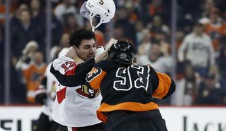 Ottawa Senators' Nick Paul, left, and Philadelphia Flyers' Jakub Voracek fight during the first period of an NHL hockey game, Saturday, Dec. 7, 2019, in Philadelphia. (AP Photo/Matt Slocum)