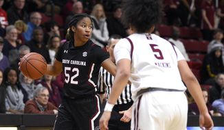 South Carolina's Tyasha Harris, left, looks to pass the ball against the defense of Temple's Marissa Mackins during the first half of an NCAA college basketball game, Saturday, Dec. 7, 2019, in Philadelphia. South Carolina won 78-71. (AP Photo/Derik Hamilton)