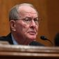 "Sen. Lamar Alexander, Tennessee Republican, called the deal on the surprise medical bills and raising tobacco purchasing age ""a very good Christmas present"" should Congress choose to unwrap it now. (Associated Press)"