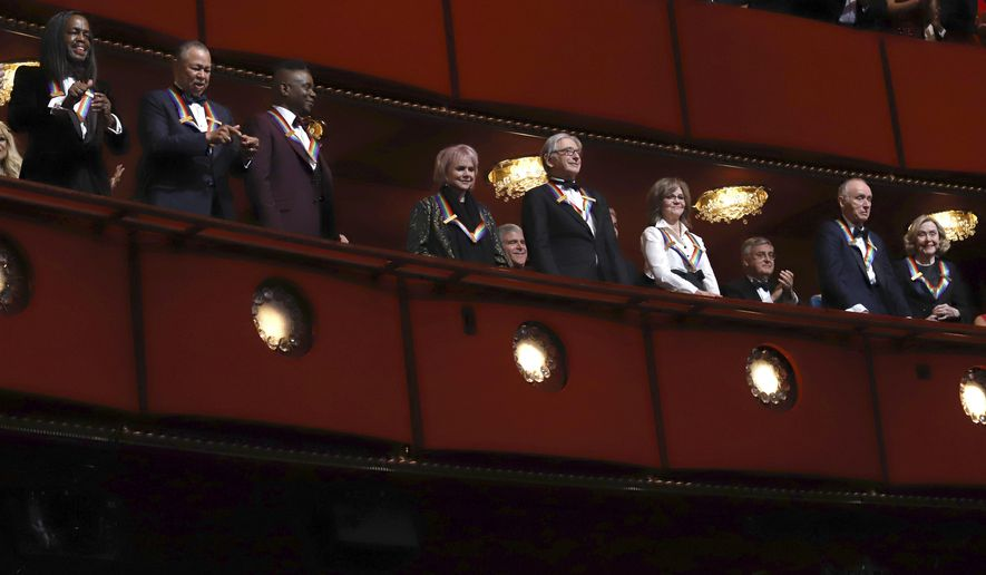 In this file photo, 2019 Kennedy Center honorees, from left, Earth, Wind & Fire members Verdine White, Ralph Johnson and Philip Bailey; singer Linda Ronstadt, conductor Michael Tilson Thomas, actress Sally Field and Sesame Street co-founders Lloyd Morrisett and Joan Ganz Cooney attend the 42nd Annual Kennedy Center Honors at The Kennedy Center on Sunday, Dec. 8, 2019, in Washington. House Republicans are questioning why the iconic performing arts center has laid off staff even after receiving $25 million in federal stimulus money. (Photo by Greg Allen/Invision/AP) **FILE**