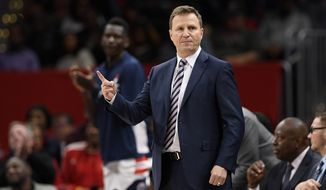 Washington Wizards head coach Scott Brooks gestures during the first half of an NBA basketball game against the Los Angeles Clippers, Sunday, Dec. 8, 2019, in Washington. (AP Photo/Nick Wass)