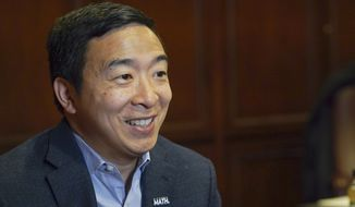 In this Dec. 5, 2019, file photo, Democratic presidential candidate businessman Andrew Yang speaks during an interview with The Associated Press in Chicago. (AP Photo/Teresa Crawford) ** FILE **
