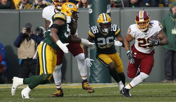 Washington Redskins' Derrius Guice runs during the first half of an NFL football game against the Green Bay Packers Sunday, Dec. 8, 2019, in Green Bay, Wis. (AP Photo/Matt Ludtke) **FILE**