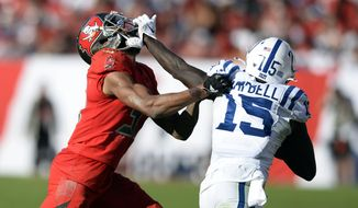 Indianapolis Colts wide receiver Parris Campbell (15) stiff arms Tampa Bay Buccaneers cornerback Carlton Davis (33) after a catch during the second half of an NFL football game Sunday, Dec. 8, 2019, in Tampa, Fla. (AP Photo/Jason Behnken)