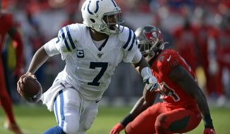 Indianapolis Colts quarterback Jacoby Brissett (7) runs away from Tampa Bay Buccaneers outside linebacker Lavonte David (54) during the second half of an NFL football game Sunday, Dec. 8, 2019, in Tampa, Fla. (AP Photo/Jason Behnken)
