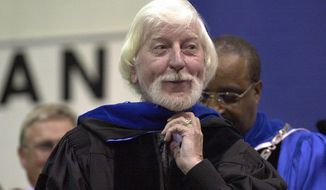 """CORRECTS SPELLING OF FIRST NAME TO CAROLL, INSTEAD OF CARROL - FILE - In a May 21, 2000, file photo, Caroll Spinney, center, best known for his TV character Big Bird from """"Sesame Street,"""" receives an honorary doctor of Humane Letters degree from Eastern Connecticut State University President David G. Carter, right, during commencement in Willimantic, Conn. Spinney, who gave Big Bird his warmth and Oscar the Grouch his growl for nearly 50 years on """"Sesame Street,"""" died Sunday, Dec. 8, 2019, at his home in Connecticut, according to the Sesame Workshop. He was 85. (AP Photo/Steve Miller, File)"""