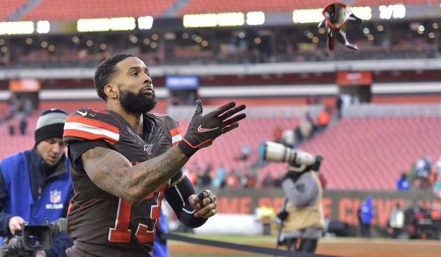 Cleveland Browns wide receiver Odell Beckham Jr. throws his gloves to a fan after an NFL football game against the Miami Dolphins, Sunday, Nov. 24, 2019, in Cleveland. Cleveland won 41-24. (AP Photo/David Richard)