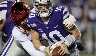 Kansas State quarterback Skylar Thompson (10) is sacked by Iowa State linebacker Will McDonald, left, during the first half of an NCAA college football game in Manhattan, Kan., Saturday, Nov. 30, 2019. (AP Photo/Orlin Wagner) ** FILE **