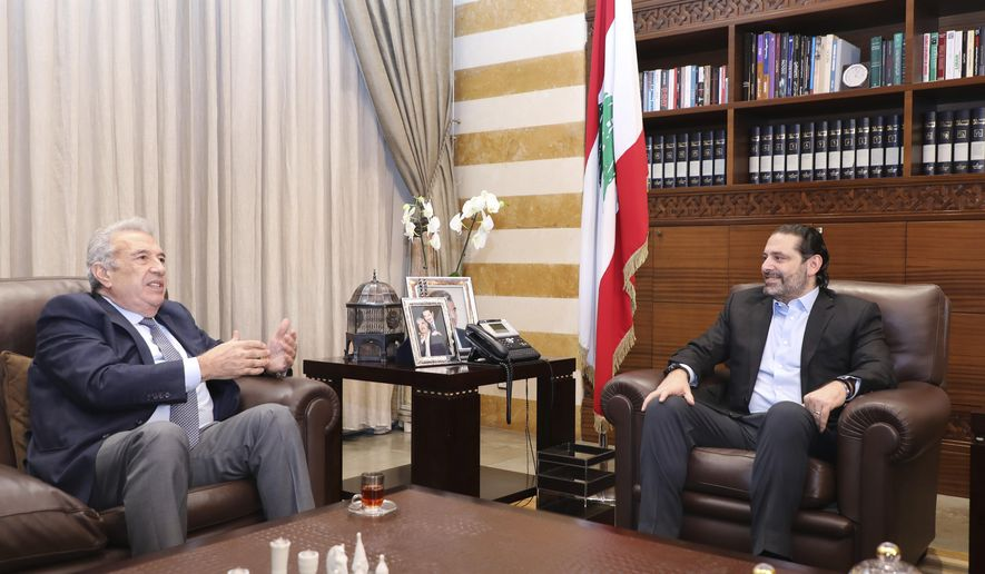 In this photo released by the Lebanese Government, Lebanon's outgoing Prime Minister Saad Hariri, right, meets with Samir Khatib, the head of a major contracting and construction and once considered a favorite candidate for the post of Prime Minister, in Beirut, Lebanon, Sunday, Dec. 8, 2019. (Dalati Nohra via AP)