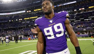 Minnesota Vikings defensive end Danielle Hunter walks off the field after an NFL football game against the Detroit Lions, Sunday, Dec. 8, 2019, in Minneapolis. The Vikings won 20-7. (AP Photo/Bruce Kluckhohn)