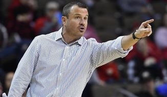 Louisville head coach Jeff Walz shouts instructions to his team during the second half of an NCAA college basketball game in Highland Heights, Ky., Sunday, Dec. 8, 2019. Louisville won 85-57. (AP Photo/Timothy D. Easley)