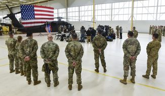 A press conference is held at the Army Aviation Support Facility, Saturday, Dec. 7, 2019, in St. Cloud, Minn., regarding the recent crash of a Black Hawk helicopter. The Minnesota National Guard says the three soldiers who were killed when their helicopter crashed near St. Cloud this week were part of a unit that returned last May from a nine-month deployment to the Middle East. (Dave Schwarz/St. Cloud Times via AP)
