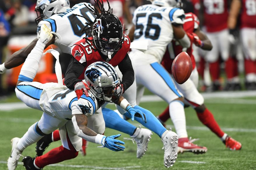 Carolina Panthers wide receiver Greg Dortch (14) misses the ball against Atlanta Falcons defensive back Kemal Ishmael (36) during the second half of an NFL football game, Sunday, Dec. 8, 2019, in Atlanta. (AP Photo/John Amis)