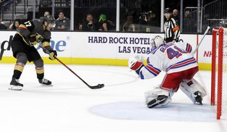 Vegas Golden Knights left wing Max Pacioretty (67) shoots against New York Rangers goalie Alexandar Georgiev during the second period of an NHL hockey game Sunday, Dec. 8, 2019, in Las Vegas. (AP Photo/Isaac Brekken)