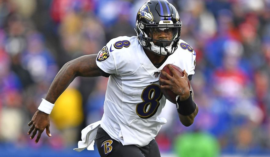 Baltimore Ravens quarterback Lamar Jackson (8) carries the ball during the second half of an NFL football game against the Buffalo Bills in Orchard Park, N.Y., Sunday, Dec. 8, 2019. (AP Photo/Adrian Kraus) ** FILE **