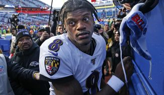 Baltimore Ravens quarterback Lamar Jackson (8) heads to the locker room after stopping to sign autographs for fans following a 24-17 win over the Buffalo Bills in an NFL football game in Orchard Park, N.Y., Sunday, Dec. 8, 2019. (AP Photo/John Munson)