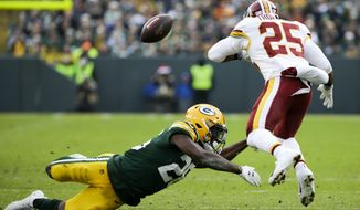 Washington Redskins' Chris Thompson fumbles as he is hit by Green Bay Packers' Darnell Savage during the second half of an NFL football game Sunday, Dec. 8, 2019, in Green Bay, Wis. The Redskins recovered the fumble. (AP Photo/Mike Roemer) ** FILE **