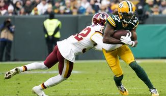 Green Bay Packers' Davante Adams tries to get past Washington Redskins' Jimmy Moreland during the second half of an NFL football game Sunday, Dec. 8, 2019, in Green Bay, Wis. (AP Photo/Morry Gash)