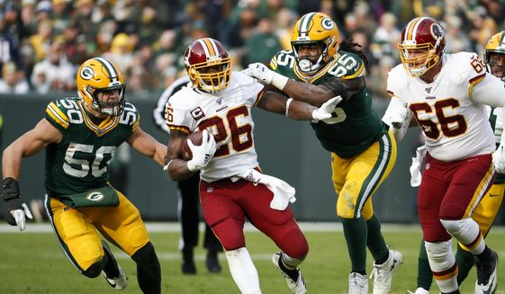 Washington Redskins' Adrian Peterson runs during the first half of an NFL football game against the Green Bay Packers Sunday, Dec. 8, 2019, in Green Bay, Wis. (AP Photo/Matt Ludtke)  **FILE**