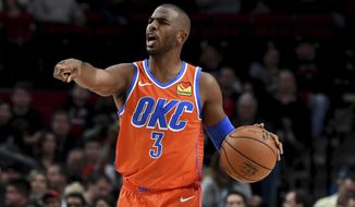 Oklahoma City Thunder guard Chris Paul directs his teammates during the first half of an NBA basketball game against the Portland Trail Blazers in Portland, Ore., Sunday, Dec. 8, 2019. (AP Photo/Steve Dykes)