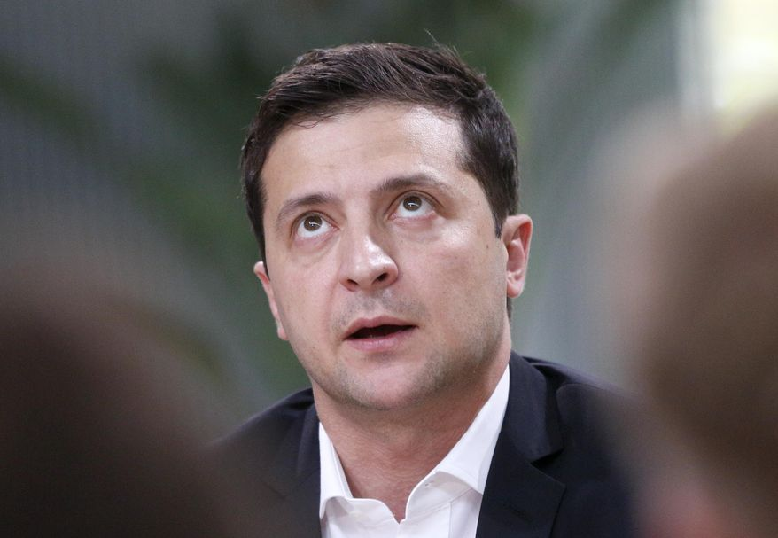 FILE In this file photo taken on Thursday, Oct. 10, 2019, Ukrainian President Volodymyr Zelenskiy speaks during talks with journalists in Kyiv, Ukraine. Ukraine's president sits down Monday, Dec. 9, 2019 for peace talks in Paris with Russian President Vladimir Putin in their first face-to-face meeting, and the stakes could not be higher. More than five years of fighting in eastern Ukraine between government troops and Moscow-backed separatists has killed more than 14,000 people, and a cease-fire has remained elusive. (AP Photo/Efrem Lukatsky, File)