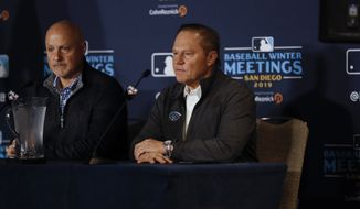 Baseball agent Scott Boras, right, listens alongside Washington Nationals general manager Mike Rizzo during a news conference at the Major League Baseball winter meetings Monday, Dec. 9, 2019, in San Diego. Nationals pitcher and World Series MVP Stephen Strasburg agreed to a record $245 million, seven-year contract on Monday. (AP Photo/Gregory Bull) **FILE**