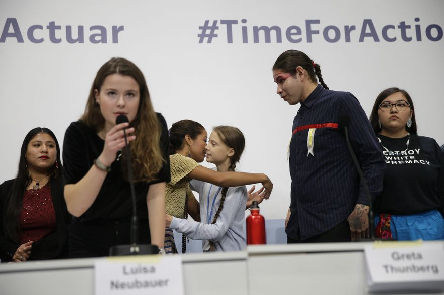Climate activist Greta Thunberg, centre right, embraces another young activist at the COP25 Climate summit in Madrid, Spain, Monday, Dec. 9, 2019. Thunberg is in Madrid where a global U.N. sponsored climate change conference is taking place. (AP Photo/Andrea Comas)