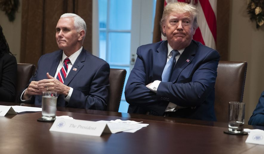 Vice President Mike Pence and President Donald Trump listen during a roundtable on school choice in the Cabinet Room of the White House, Monday, Dec. 9, 2019, in Washington. (AP Photo/ Evan Vucci)