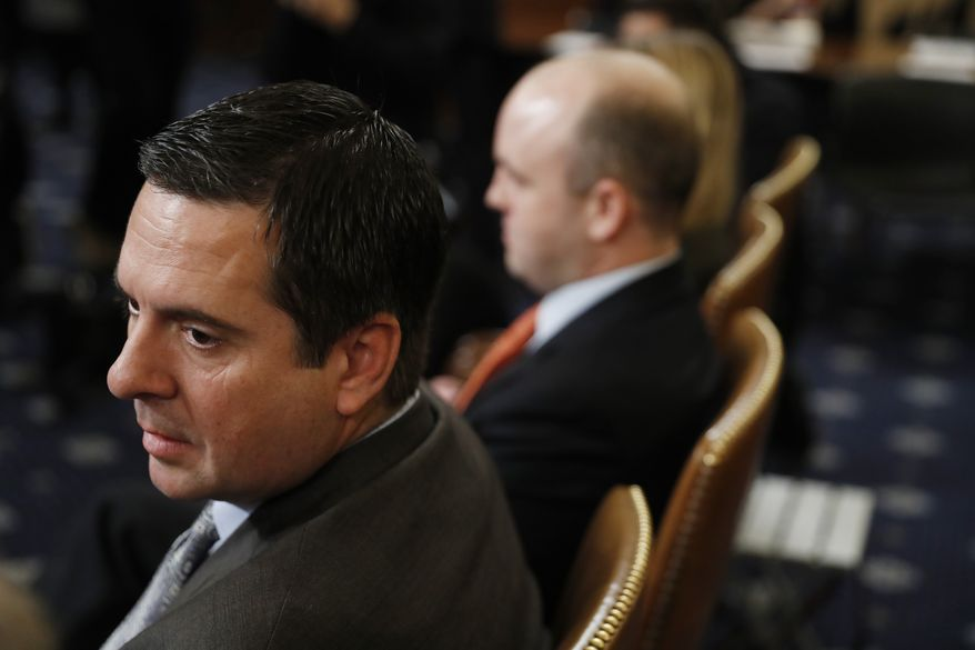 Rep. Devin Nunes, R-Calif, left, the ranking member of the House Intelligence Committee, listens as the House Judiciary Committee hears investigative findings in the impeachment inquiry of President Donald Trump, Monday, Dec. 9, 2019, on Capitol Hill in Washington. (AP Photo/Andrew Harnik)