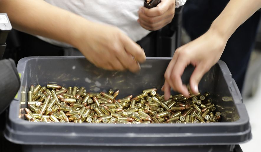 In this July 16, 2019, photo, officers at Washington state's Basic Law Enforcement Academy load gun clips with ammunition as they take part in training exercises at a firing range in Burien, Wash. Accidental shootings by police happen across the United States every year, an Associated Press investigation has found, and cadets at Washington's academy, which is required for all entry-level Washington state law enforcement officers, must have 90 hours of firearms training, but requirements in other states vary widely. (AP Photo/Ted S. Warren)