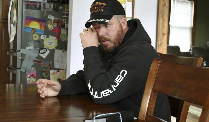 In this Nov. 1, 2019, photo, Gabe Steele wipes his eye as he sits in his home in West Point, Iowa, and talks about the accidental fatal shooting of his wife, Autumn Steele, by a Burlington, Iowa police officer in 2015. Accidental shootings by police happen across the United States every year, an Associated Press investigation has found, and experts say it's because law enforcement officers don't get the training they need. (AP Photo/Matthew Holst)