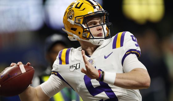 FILE - In this Dec. 7, 2019, file photo, LSU quarterback Joe Burrow (9) warms up before the Southeastern Conference championship NCAA college football game against Georgia, in Atlanta. Burrow is a unanimous selection as the offensive player of the year on The Associated Press All-Southeastern Conference football team, Monday, Dec. 9, 2019. (AP Photo/John Bazemore) ** FILE **